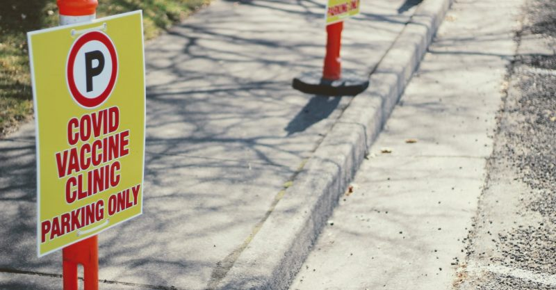 Covid vaccine clinic parking only signs mark a potential first-amendment-free zone